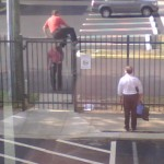 a photo of a Cruise Director from another cruise line trying to jump the fence at Carnival'sHeadquarters