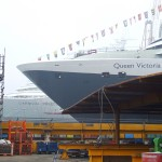 Queen Victoria side by side with the Carnival Freedom