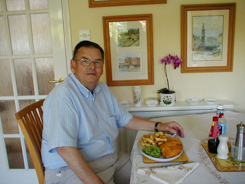 FISH AND CHIPS - THE SHOP, MY DAD AND THE PRODUCT, THE PRODUCT ON A PLATE (NOTE THE MUSHY PEAS) AND MY DAD EATING THEM.