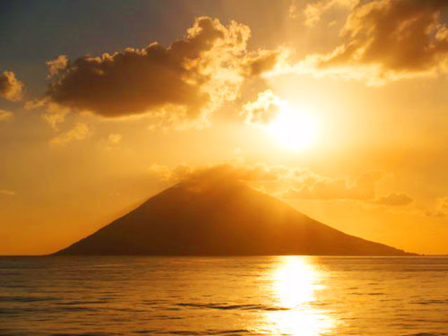 Here are 2 beautiful photos of our passage past the volcanic island of Stromboli taken by Charlie, our Musical Director.