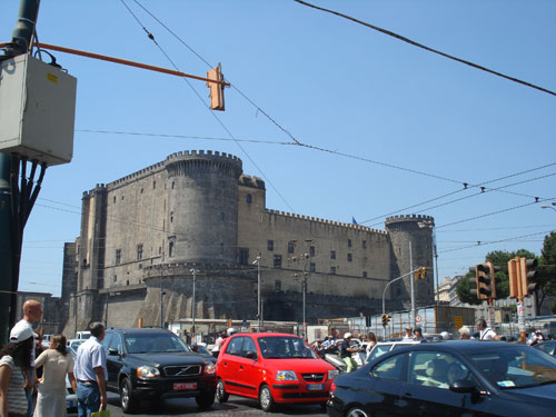 4. The Fortress near the port and a typical busy road in Naples