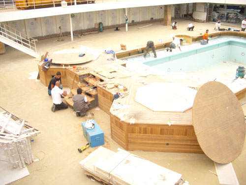 7. Hard at work on one of the swimming pools.