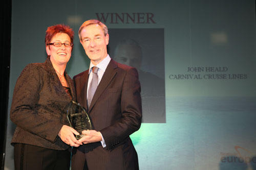 Here David Dingle, Chief Executive Officer of Carnival U.K. accepting the trophy award from Mary Bond, Editor, Seatrade Cruise Review & Seatrade Insider