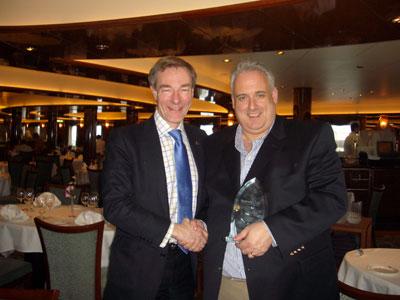 John receives his Seatrade Award from CEOof Carnival U.K. - Mr. DavidDingle
