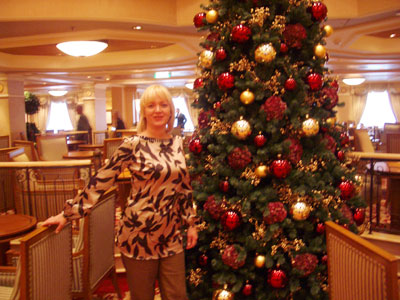 Heidi celebrates Christmas on the Queen Victoria, clothes sponsored by Jean Claude Penny.