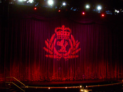 The Cunard crest on the curtain in the theatre used for the naming ceremony