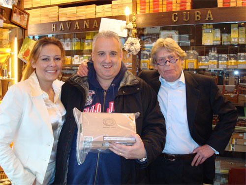 John in his favorite cigar store in Holland with the owner John Andringa and his lovely daughter Georgina