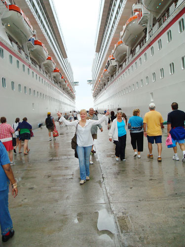 1. Heidi standing between the Carnival Freedom and Carnival Liberty