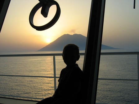my-nephew-luke-sitting-on-the-bridge-as-we-passed-the-volcanoes-stromboli-last-year.jpg