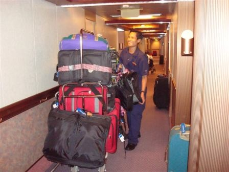 the-hard-working-staff-picking-up-the-luggage-from-the-guest-corridors.jpg