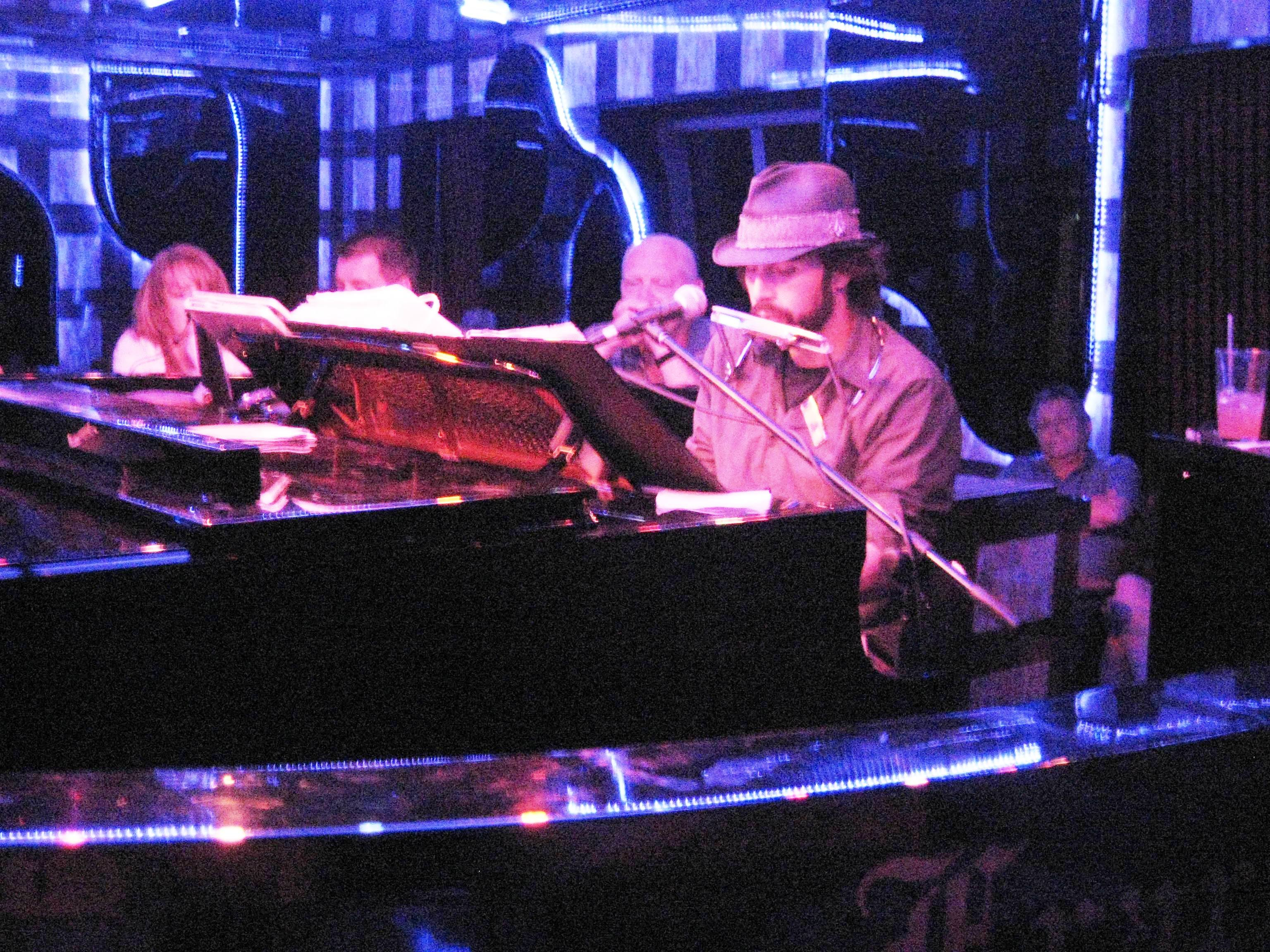 greg-with-guests-enjoying-his-entertainment-in-the-piano-bar-see-if-you-can-find-mickey-his-newly-appointed-manager